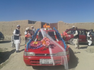 A decorated car often accompanies the bride as she travels from her parent's house to the house of new in-laws. In this wedding in the Ibrahimzi area of Deh Yak district in Ghazni province, the bride price was 11,000 US dollars. (Author's photo: 2014)
