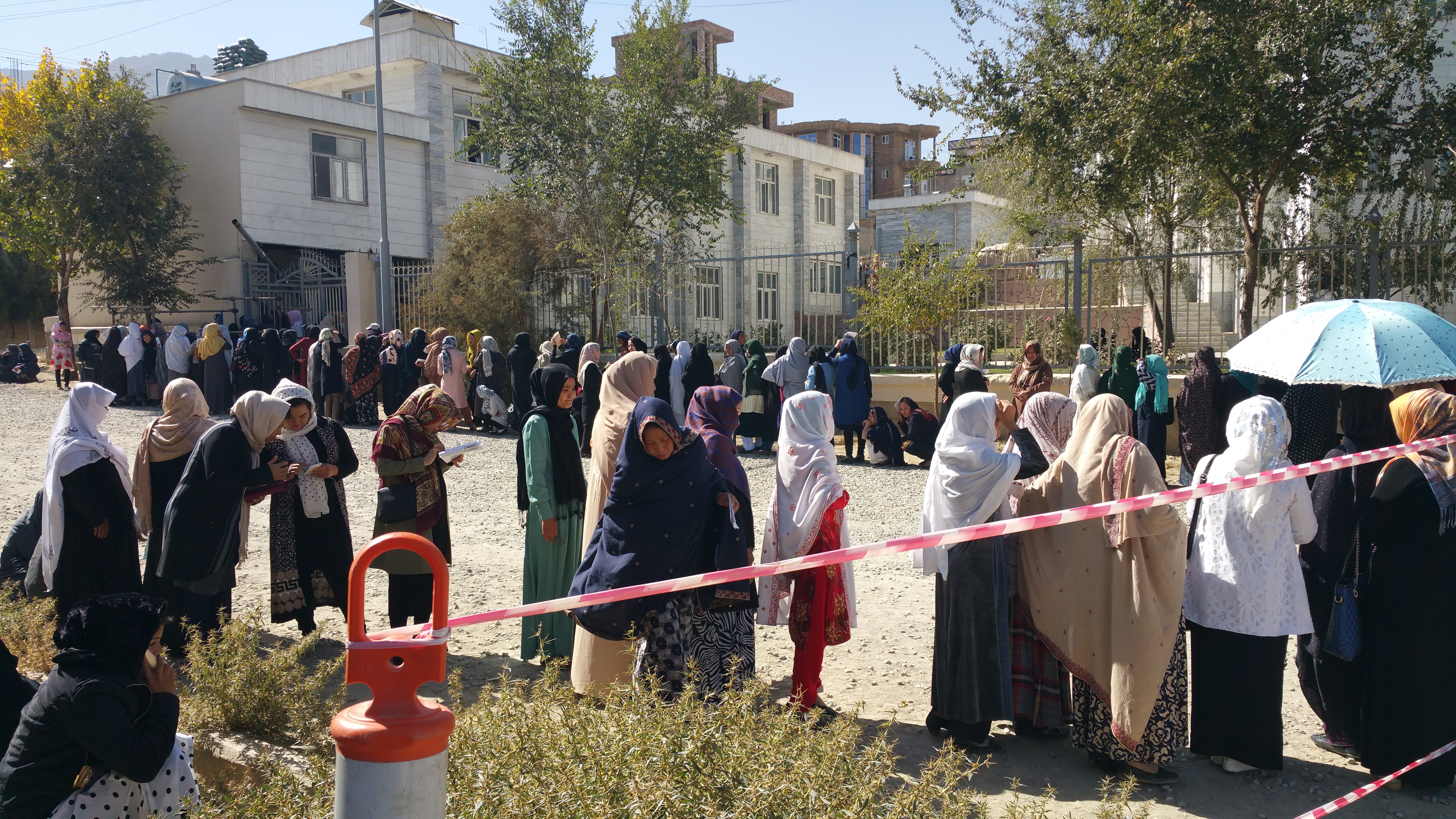 Women voters standing in the queue outside the polling stations to vote during the second day of the Afghan parliamentary elections on 21 October 2018. Photo Photo: Ali Yawar Adili