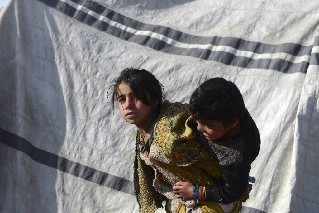 Children in an IDP camp in Dand district, Kandahar province. Thousands of people fled their homes after Taleban offensives in Helmand and Kandahar provinces in October and November 2020, and ANSF counter-offensives. Photo: Javed Tanveer/AFP, 7 January 2021.