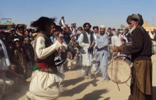 Men dance the attan in Andar district of Ghazni, Eid al Fitr, 28 October, 2012. Photo: Fazal Mazhary