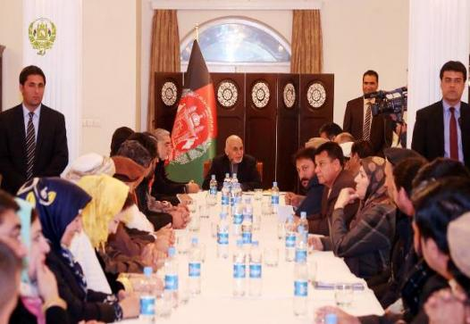 A group of people seated around the table, headed by president Ghani.
