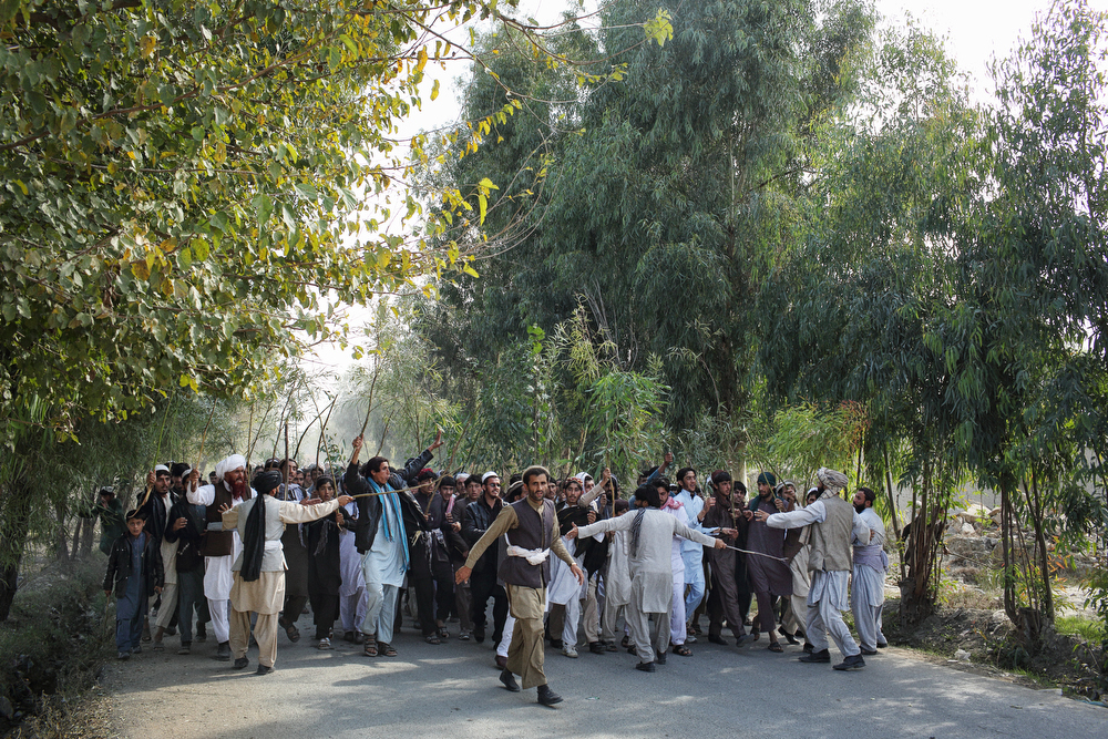 The morning after two men were killed by the CIA-funded Khost Protection Force in a raid, hundreds of men, some carrying Taleban flags, protested against the deaths in a procession on the outskirts of Khost City. November 7, 2015.